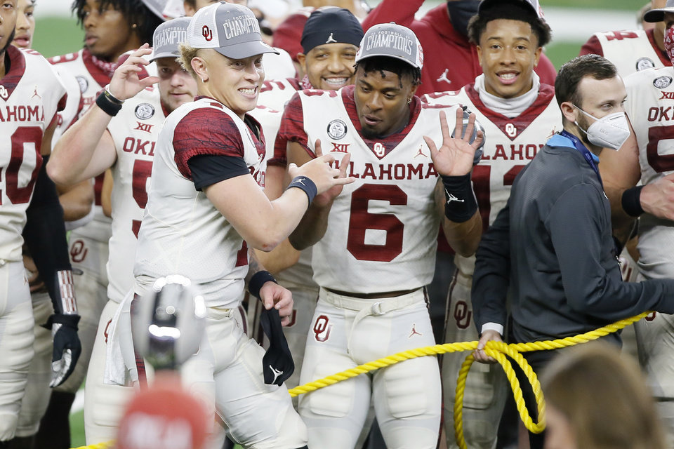 Photo - Oklahoma's Spencer Rattler (7) and Tre Brown (6) celebrate during the Big 12 Championship Game between the University of Oklahoma Sooners (OU) and the Iowa State Cyclones at AT&T Stadium in Arlington, Texas, Saturday, Dec. 19, 2020. Oklahoma won 27-21. [Bryan Terry/The Oklahoman]