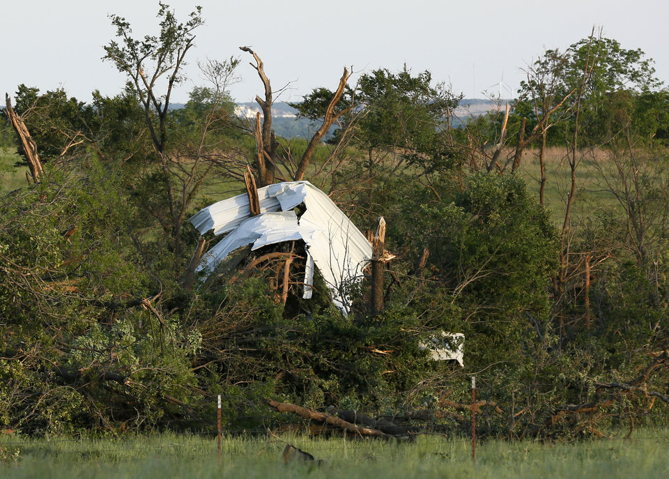 Photo - Metal is caught in damaged trees after a tornado hit along County Road 1680 and east of Indian Meridian Rd., west of Wynnewood, Okla., in rural Gavin County, Monday, May 9, 2016. Photo by Nate Billings, The Oklahoman