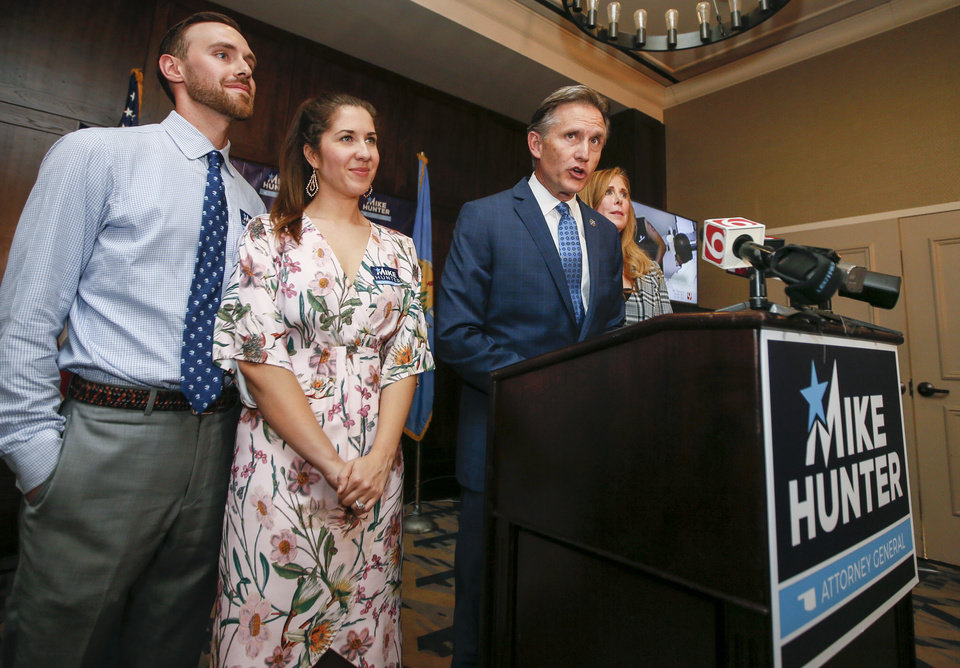 Photo - Attorney General Mike Hunter speaks next to his wife, Cheryl Hunter, right, son Barrett Hunter, left, and daughter-in-law Rachael Hunter, at the Renaissance Waterford Oklahoma City Hotel in Oklahoma City, Tuesday, June 26, 2018. Photo by Nate Billings, The Oklahoman