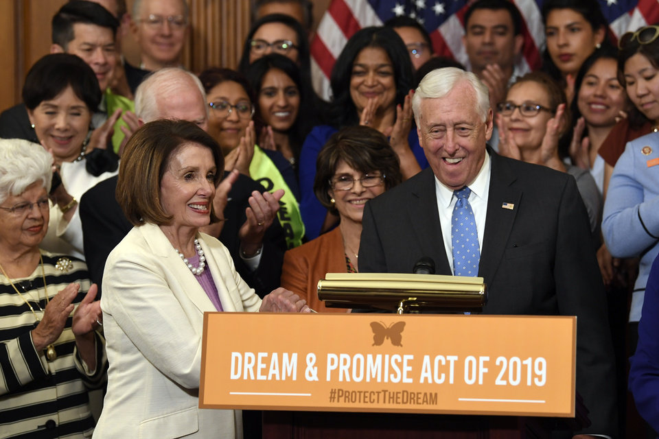 Photo -  House Speaker Nancy Pelosi of Calif., front left, shakes hands with House Minority Whip Steny Hoyer, D-Md. front right, during an event on Capitol Hill in Washington, Tuesday, June 4, 2019, regarding the American Dream and Promise Act which offers a pathway to citizenship for those with Deferred Action for Childhood Arrivals (DACA), Temporary Protected Status (TPS), and Deferred Enforced Departure (DED) and similarly situated immigrants who have spent much of their lives in the United States. [AP photo]