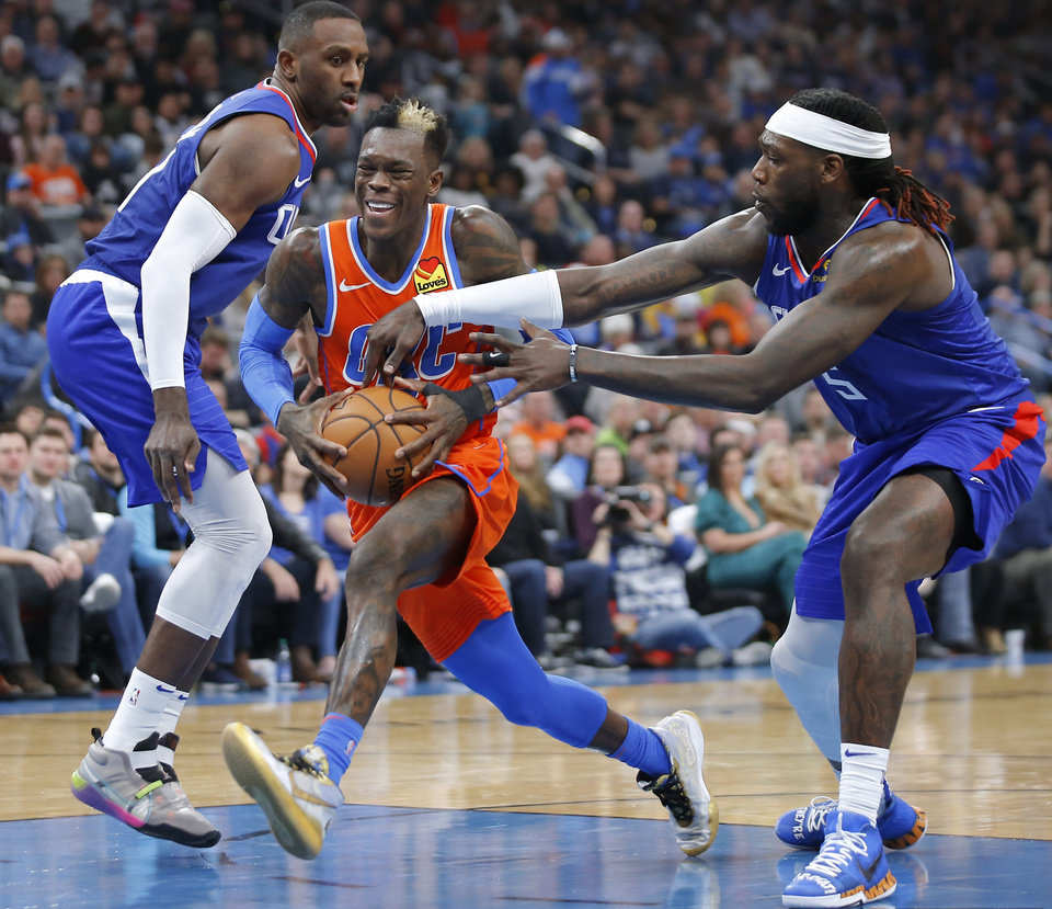 Photo - Oklahoma City's Dennis Schroder (17) between LA's Patrick Patterson (54) and Montrezl Harrell (5) during an NBA basketball game between the Oklahoma City Thunder and the LA Clippers at Chesapeake Energy Arena in Oklahoma City, Sunday, Dec. 22, 2019. Oklahoma City won 118-112. [Bryan Terry/The Oklahoman]