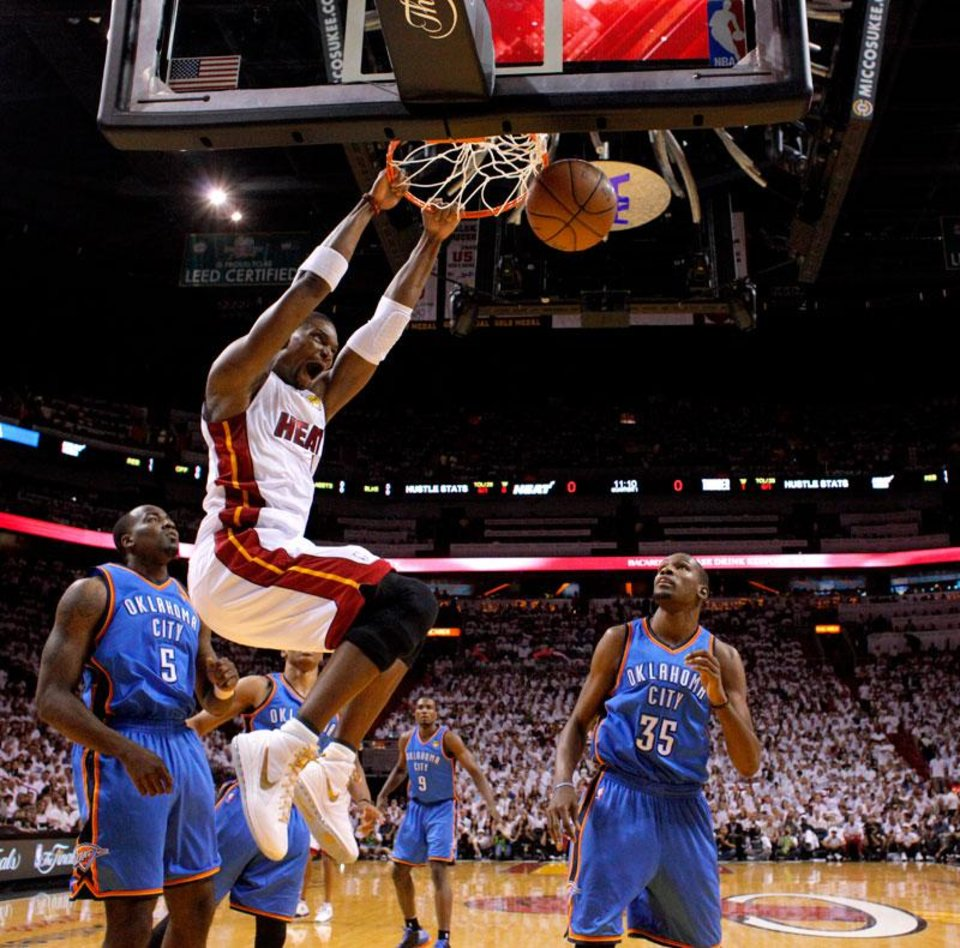 Photo -  Miami's Chris Bosh (1) dunks the ball as Oklahoma City's Kendrick Perkins (5) and Oklahoma City's Kevin Durant watch during Game 3 of the NBA Finals between the Oklahoma City Thunder and the Miami Heat at American Airlines Arena, Sunday, June 17, 2012. Photo by Bryan Terry, The Oklahoman