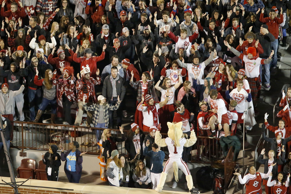 Photo - Fans cheer during an NCAA football game between the University of Oklahoma Sooners (OU) and the TCU Horned Frogs at Gaylord Family-Oklahoma Memorial Stadium in Norman, Okla., Saturday, Nov. 23, 2019. Oklahoma won 28-24. [Bryan Terry/The Oklahoman]