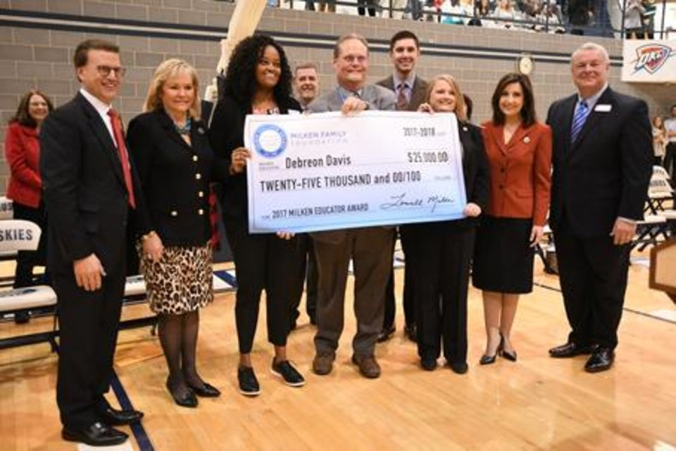 Photo - Debreon Davis, principal at Edmond North High School, received a $25,000 Milken Educator Award from Lowell Milken on Dec. 7, 2017. (Provided by Oklahoma State Dept of Education)