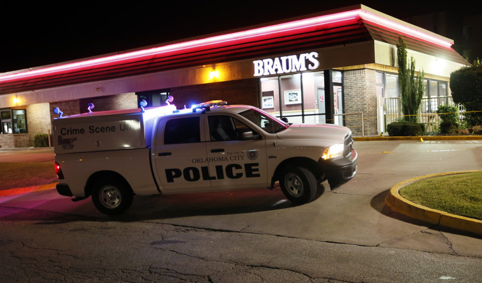 Photo - Oklahoma City police work the scene at a Braum's restaurant on May and NW 112th St. where Labor Commissioner Mark Costello was fatally stabbed, Sunday, Aug. 23, 2015.  Photo by Nate Billings, The Oklahoman