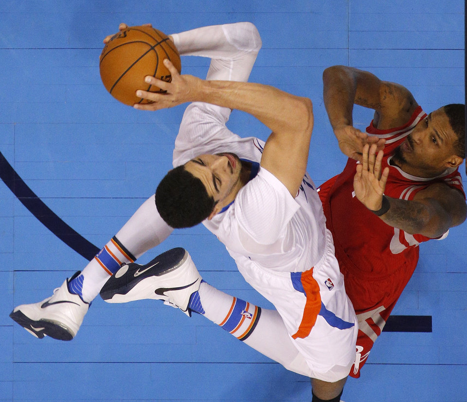 Photo - Oklahoma City's Enes Kanter (11) outs up a shot beside Houston's Trevor Ariza (1) during an NBA basketball game between the Oklahoma City Thunder and the Houston Rockets at Chesapeake Energy Arena in Oklahoma City, Tuesday, March 22, 2016. Photo by Bryan Terry, The Oklahoman