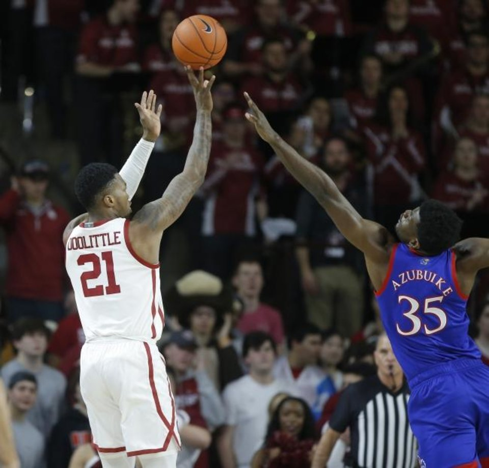 Photo -  Oklahoma's Kristian Doolittle attempts a shot over Kansas' Udoka Azubuike during a Tuesday night Big 12 game at Lloyd Noble Center. [Bryan Terry/The Oklahoman]