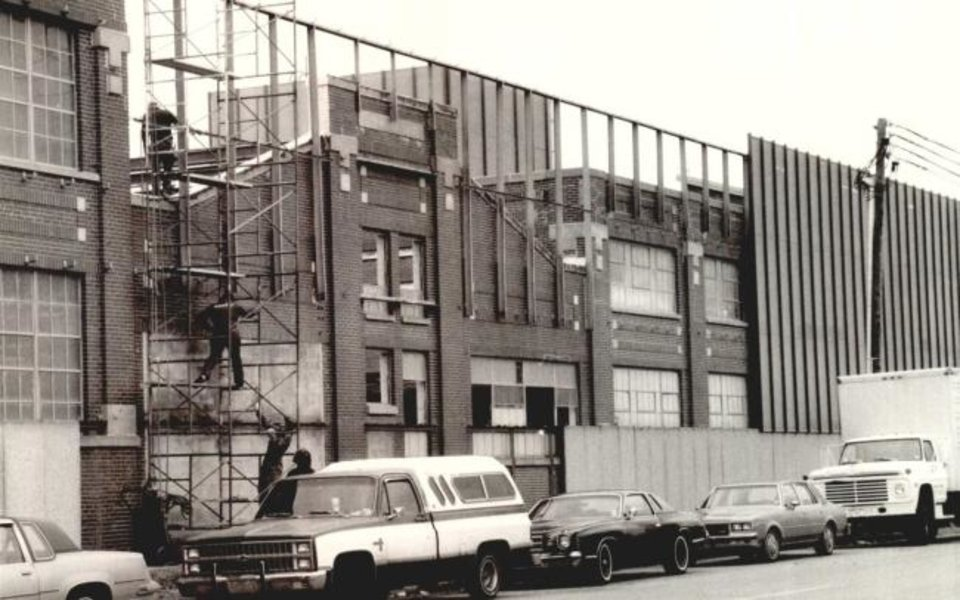 Photo -  Gold-colored screening is installed in the 1980s in front of the decades-old facade of the OGE Energy Corp. data center, when the area was already in a years-long decline. [Oklahoma Historical Society]
