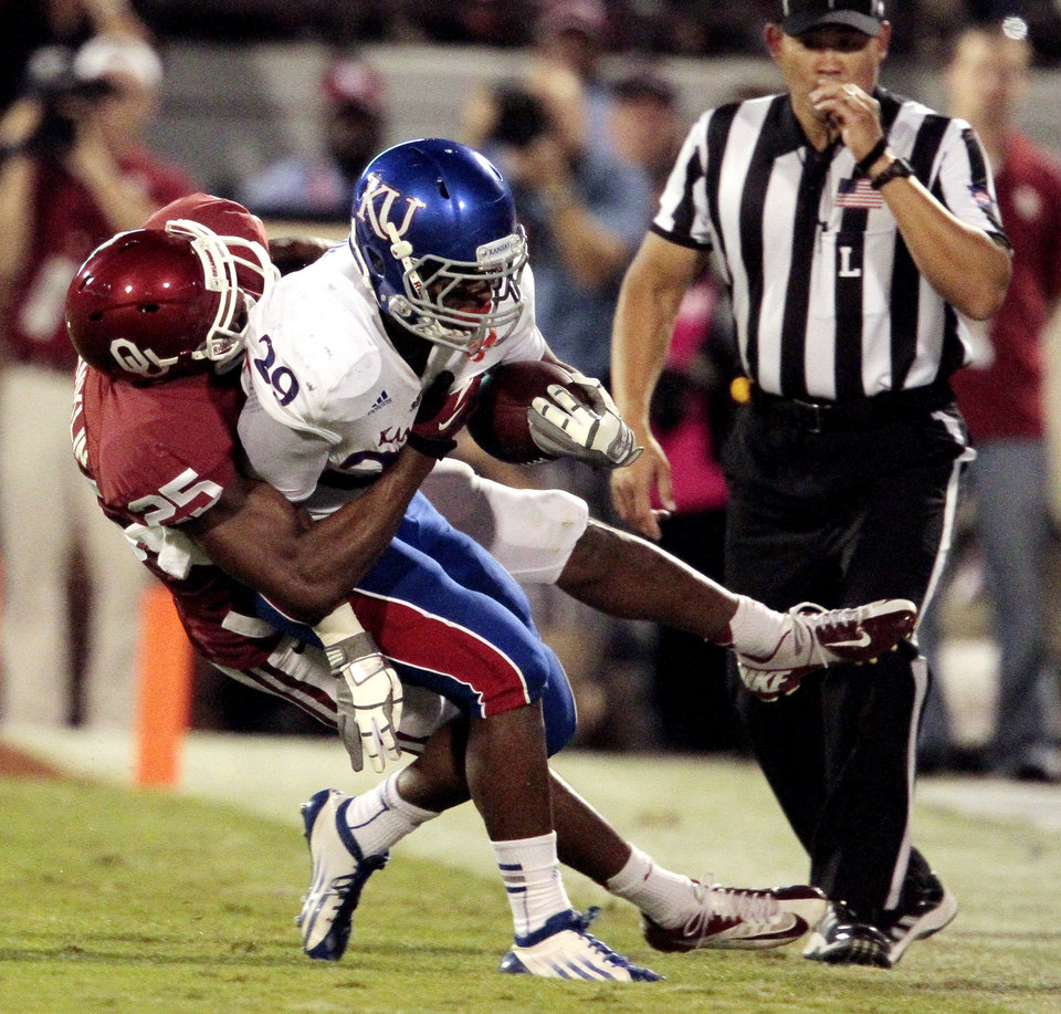 Photo - Aaron Franklin (25) brings down James Sims (29) during the college football game between the University of Oklahoma Sooners (OU) and the University of Kansas Jayhawks (KU) at Gaylord Family-Oklahoma Memorial Stadium in Norman, Okla., on Saturday, Oct. 20, 2012. Photo by Steve Sisney, The Oklahoman