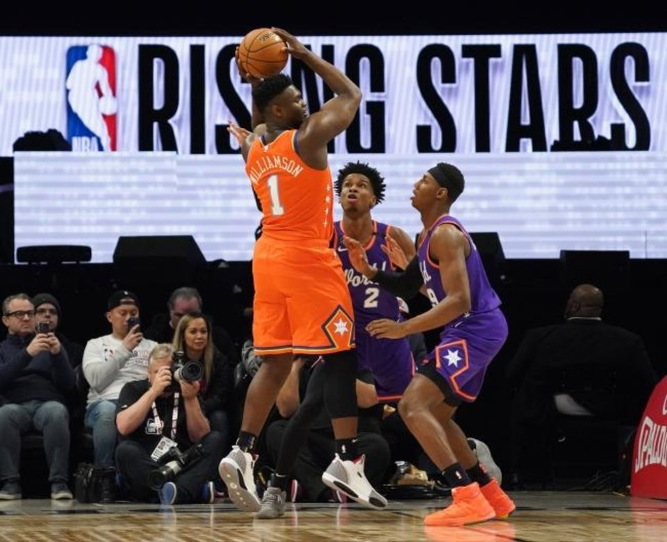 Photo -  Canadians Shai Gilgeous-Alexander (2) and R.J. Barrett (right) guard Zion Williamson during the NBA Rising Stars game Feb. 14 at Chicago's United Center. [Kyle Terada/USA TODAY Sports]