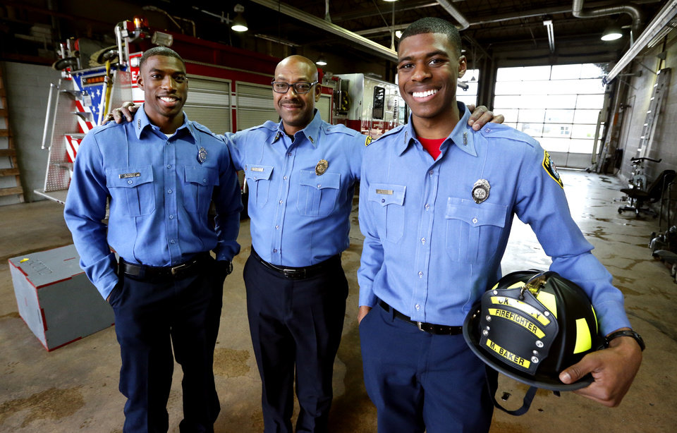 Photo -  Top: Firefighter  Jack Baker poses with  sons Javvero, left, and Malcolm.  The younger son, Malcolm, graduated Friday from the Oklahoma City Fire Department's training academy.  [Photo by Steve Sisney, The Oklahoman]