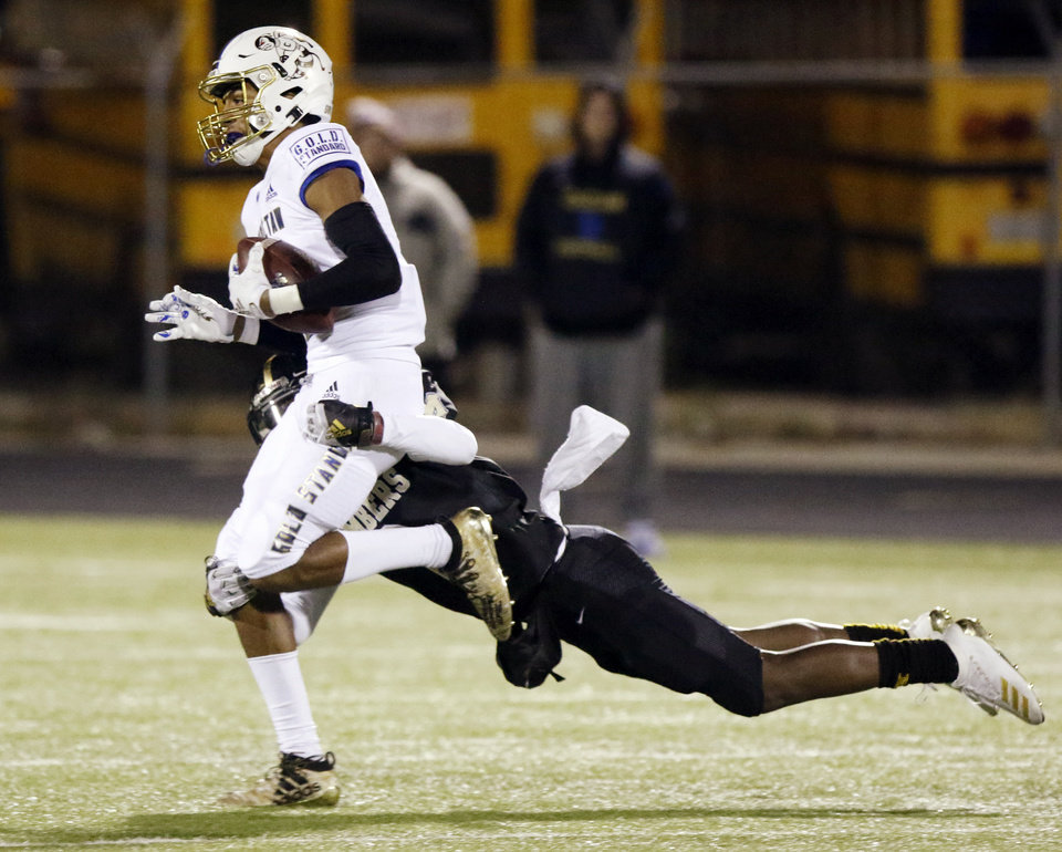 Photo - Choctaw's Chase Jackson (9) is tackled by Midwest City's Makale Smith (2) after a catch during a high school football game between Midwest City and Choctaw at Rose Field in Midwest City, Okla., Friday, Nov. 1, 2019. [Nate Billings/The Oklahoman]