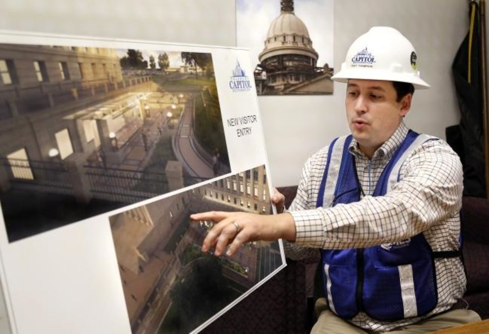 Photo -  Trait Thompson explains renderings showing the new visitor entry and plaza being built on the southeast side of the building on July 24. Thompson is manager for the Capitol Restoration Project. The project is expected to be complete in 2022. [Jim Beckel/The Oklahoman]
