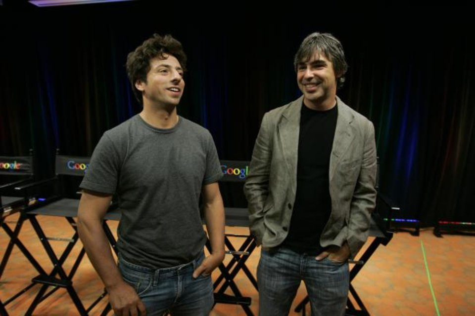 Photo -  Google co-founders Sergey Brin, left, and Larry Page speak during a news conference at Google Inc. headquarters in Mountain View, Calif. [AP PHOTO]