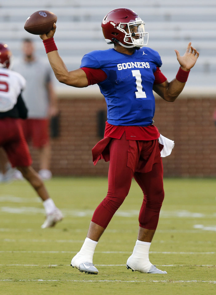 Photo - OU quarterback Jalen Hurts (1) throws during football practice for the University of Oklahoma Sooners in Norman, Okla., Monday, Aug. 12, 2019. [Nate Billings/The Oklahoman]