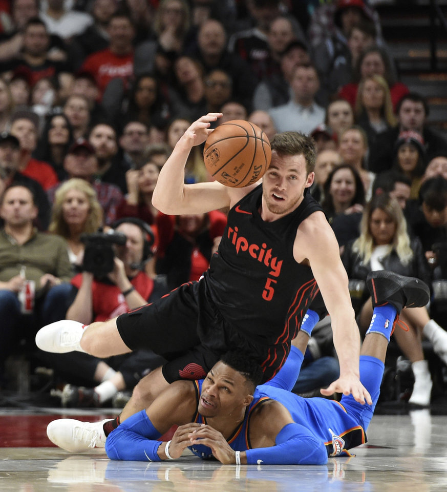Photo -  Portland Trail Blazers guard Pat Connaughton, top, grabs a loose ball as he lands on Oklahoma City Thunder guard Russell Westbrook during the second half of Saturday's game in Portland, Ore. The Blazers won, 108-100. [AP PHOTO]