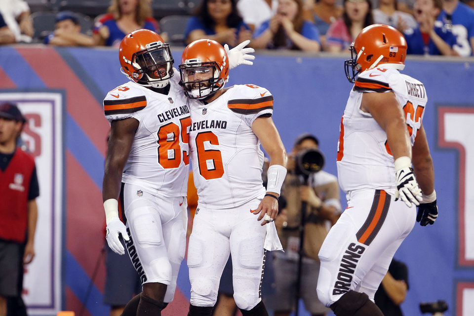 Photo - Cleveland Browns tight end David Njoku (85) celebrates a touchdown catch with quarterback Baker Mayfield (6) as Austin Corbett (63) joins them during the first half of a preseason NFL football game against the New York Giants, Thursday, Aug. 9, 2018, in East Rutherford, N.J. (AP Photo/Adam Hunger)