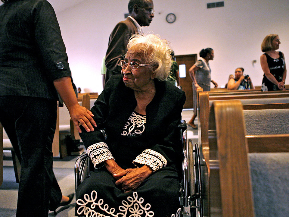 Photo - Clara Luper is greeted with a pat on the arm by an audience member during Freedom Fiesta's Week Celebration Doc Williams Day at Friendship Baptist Church in Oklahoma City on Sunday, August 17, 2008. By John Clanton, The Oklahoman ORG XMIT: KOD