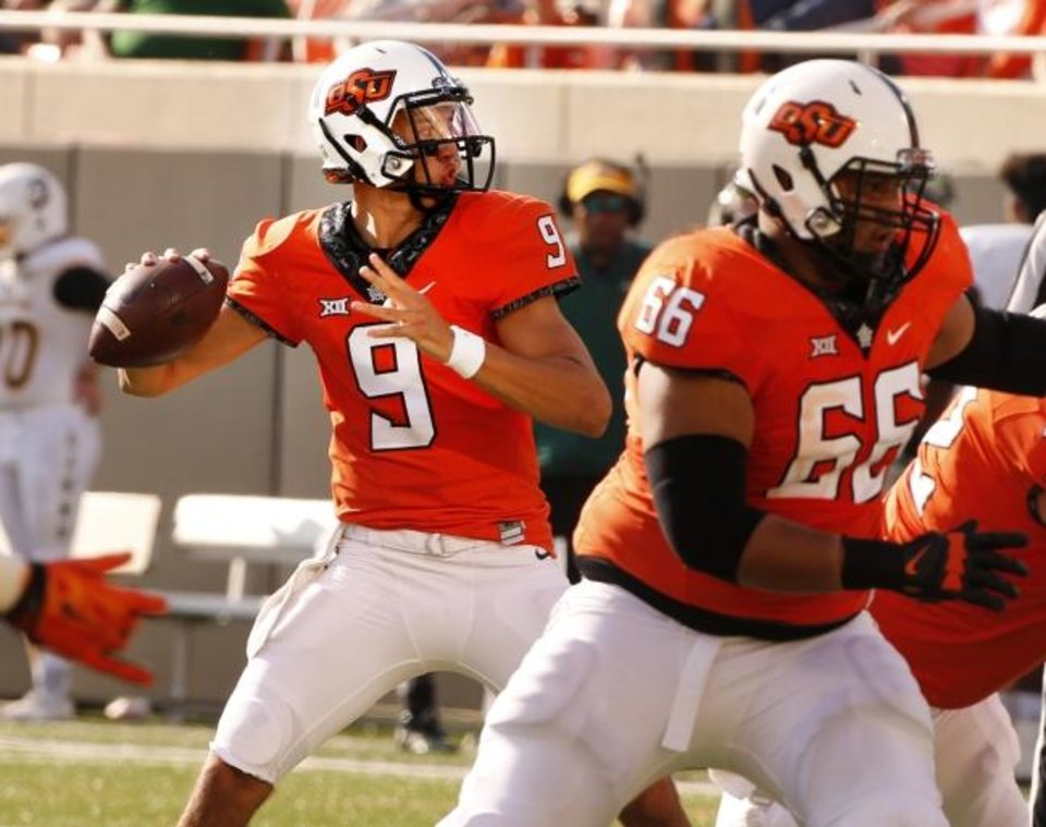 Photo -  Former Oklahoma State quarterback John Kolar throws a pass during a 2015 game vs. Southeast Louisiana. Kolar is now a graduat transfer football player at Iowa State, where he has reunited with his younger brother, Charlie. [Steve Sisney/The Oklahoman Archives]