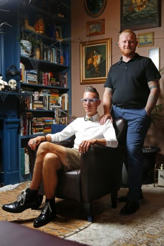 Photo -  Married couple Matt, left, and Brad Kirouac pose for a photo Wednesday at The Study in Oklahoma City. [Bryan Terry/The Oklahoman]
