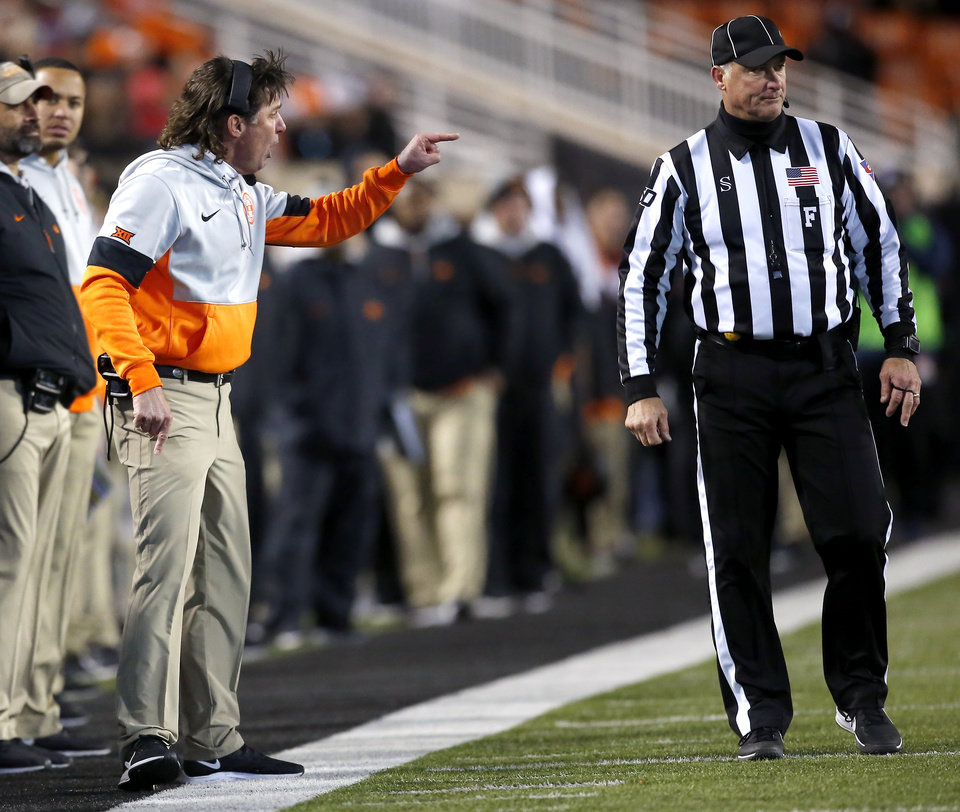 Photo - Oklahoma State head coach Mike Gundy argues for a cal in the third quarter during the Bedlam college football game between the Oklahoma State Cowboys (OSU) and Oklahoma Sooners (OU) at Boone Pickens Stadium in Stillwater, Okla., Saturday, Nov. 30, 2019. OU won  34-16. [Sarah Phipps/The Oklahoman]