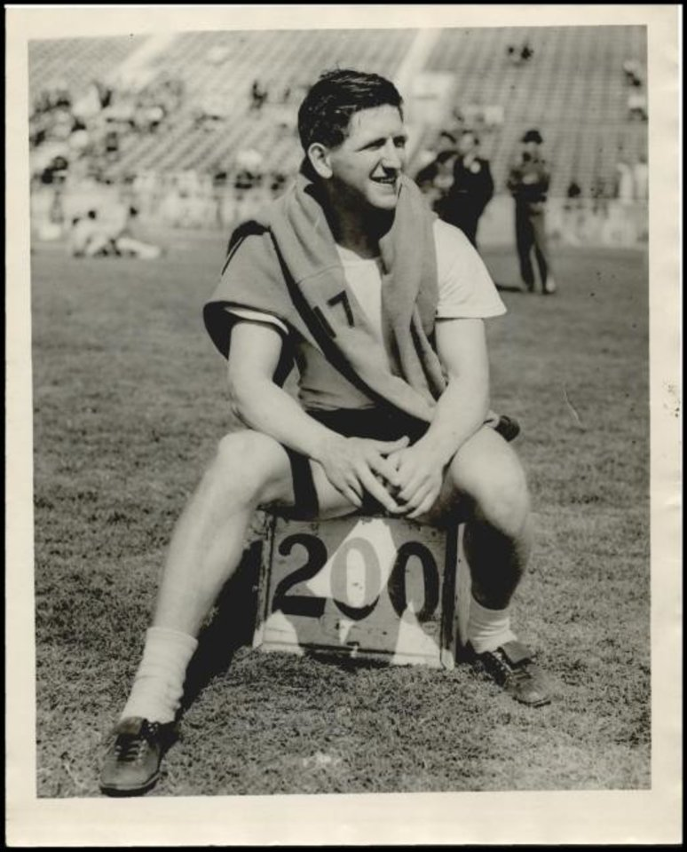 Photo -  Spring 1937: Bob Peoples sits on the 200-foot marker. The Classen High School senior set the national high school record for javelin that year with a throw of 220 feet, 1 inch, a record that stood for more than two decades. [THE OKLAHOMAN ARCHIVE]
