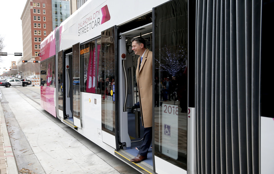 Photo - Oklahoma City Mayor David Holt walks off a streetcar before grand open ceremonies for the Oklahoma City Streetcar system at Leadership Square,  Friday, Dec. 14, 2018. Photo by Sarah Phipps, The Oklahoman