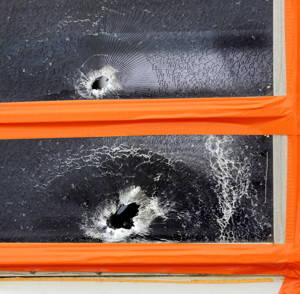 Photo - Large holes are shown in side windows of this camper trailer when they were struck  by gunfire Sunday night, beginning a crime spree by Michael Dale Vance that spanned multiple counties. Camper is on this property, 920819 S. 3310 Rd., in Lincoln County where Tony Heavner lives.  Vance engaged in a shootout with Wellston police officers, injuring two of them.  He then stole one of the officer's vehicle and continued his crime spree, carjacking a vehicle from a Wellston couple, and then driving to the home in nearby town of Luther where he is believed to have killed the man and woman who lived there. . Photo by Jim Beckel, The Oklahoman