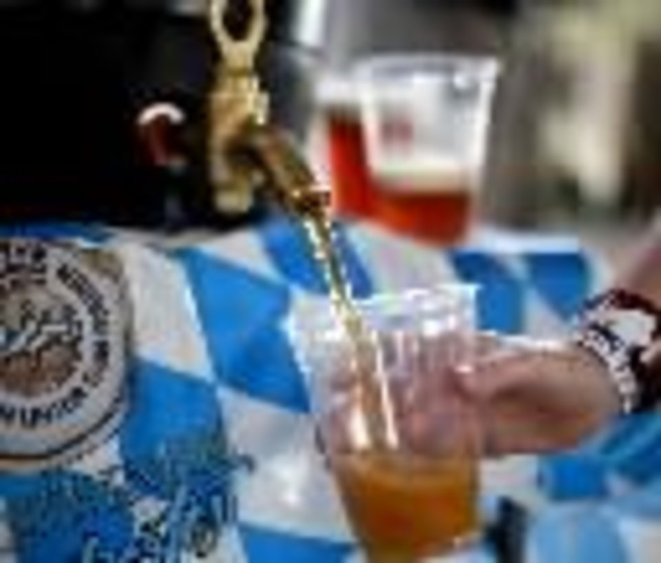 Photo -  COOP's special Oktoberfest lager led off opening activities in Choctaw.