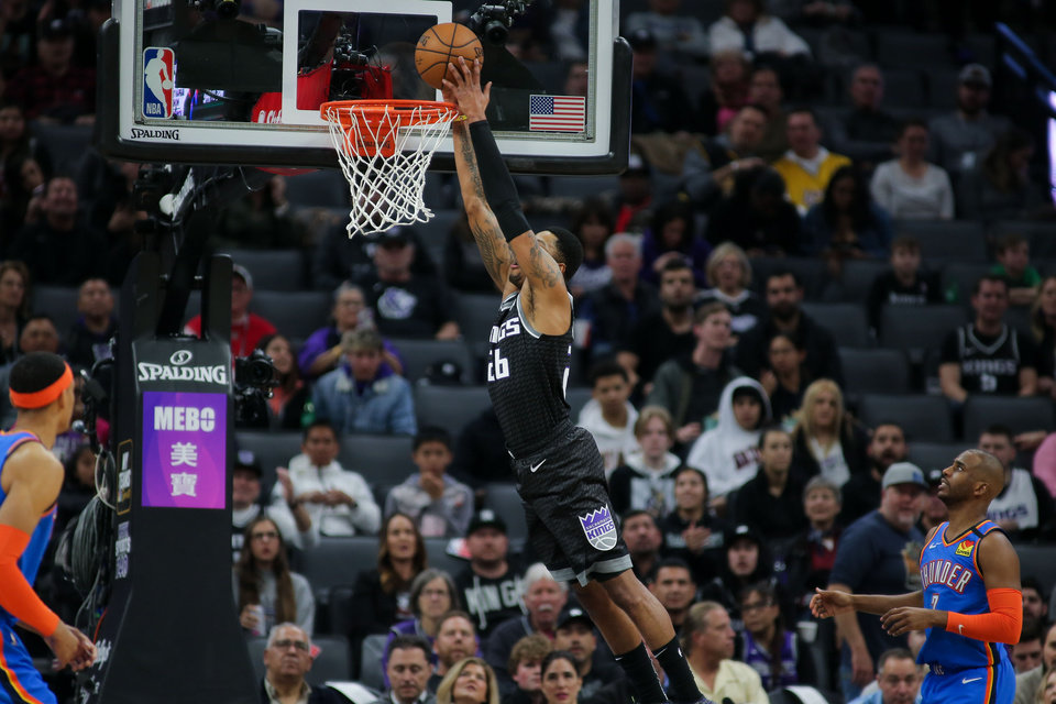Photo - Jan 29, 2020; Sacramento, California, USA; Sacramento Kings guard Kent Bazemore (26) dunks the ball during the second quarter against the Oklahoma City Thunder at Golden 1 Center. Mandatory Credit: Sergio Estrada-USA TODAY Sports