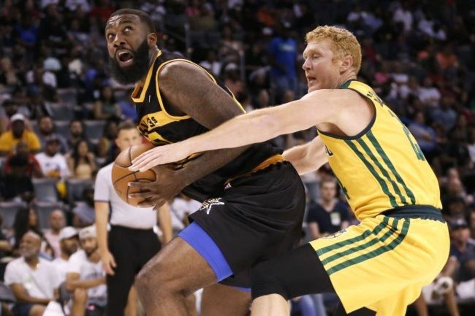 Photo -  Killer 3s Donte Greene, left, tries maintain control of the ball as the Ball Hogs' Brain Scalabrine reaches in during Sunday's BIG3 basketball tournament at Chesapeake Energy Arena. [Paxson Haws/The Oklahoman]