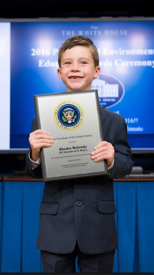 Photo -  Rhodes Molenda, 6, of Edmond, proudly displays his official President's Environmental Youth Award. [Photo provided]