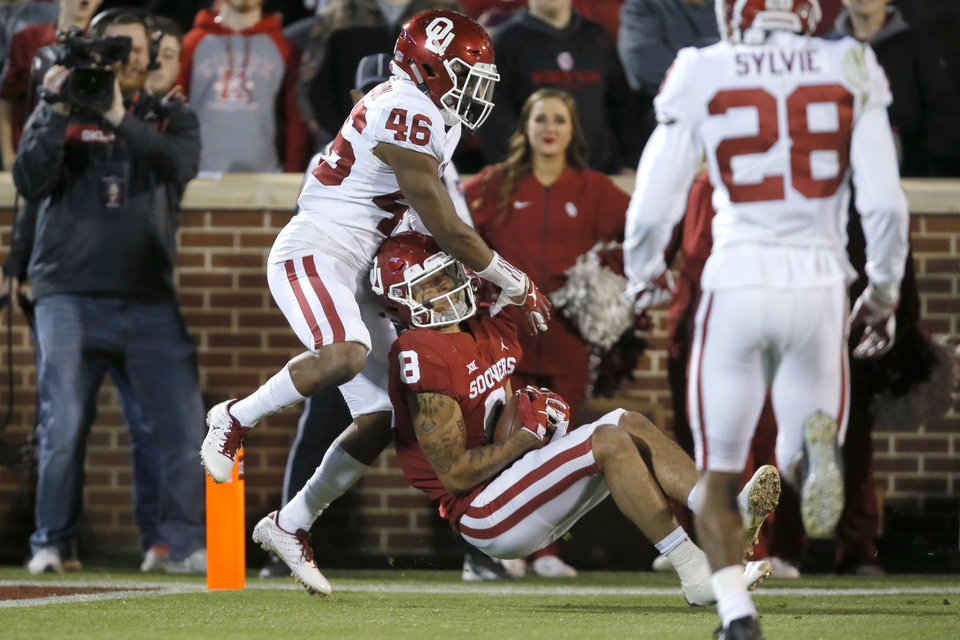 Photo - Oklahoma's Trejan Bridges (8) catches the ball in front of Oklahoma's Robert Charlton (46) during the University of Oklahoma's (OU) spring football game at Gaylord Family-Oklahoma Memorial Stadium in Norman, Okla., Friday, April 12, 2019. Photo by Bryan Terry, The Oklahoman