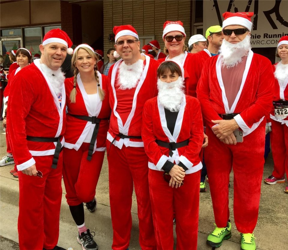 Photo - Gateway Mortgage Group employees participate in a Christmas run.
