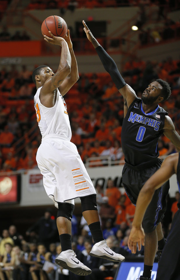 Photo - Oklahoma State's Marcus Smart (33) shoots the ball over Memphis' Damien Wilson during an NCAA college basketball game between Oklahoma State and Memphis at Gallagher-Iba Arena in Stillwater, Okla., Tuesday, Nov. 19, 2013. Photo by Bryan Terry, The Oklahoman