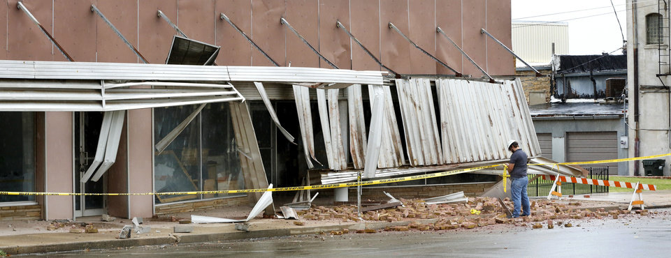 Photo - Damage to the front of a building near Cleveland and Moses in downtown Cushing on Monday, Nov. 7, 2016, caused by Sunday night's 5.0 magnitude earthquake. Photo by Jim Beckel, The Oklahoman
