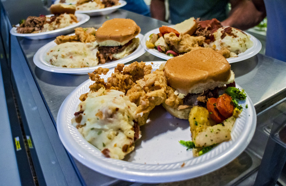 Photo - Food prepared by 84 Hospitality as they work the kitchen of The Westtown day shelter at the Homeless Alliance to make lunch for the shelter's clients in Oklahoma City, Okla. on Monday, May 6, 2019.    [Chris Landsberger/The Oklahoman]