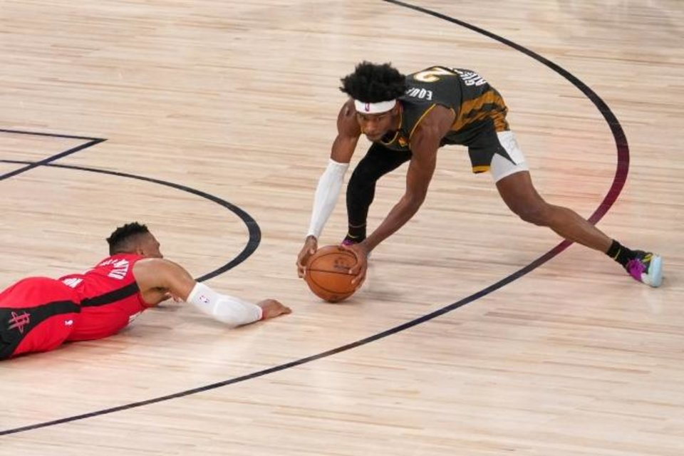 Photo -  Houston Rockets' Russell Westbrook (0) looks on as Oklahoma City Thunder's Shai Gilgeous-Alexander (2) wins control of a loose ball during the second half of an NBA first-round playoff basketball game, Monday, Aug. 31, 2020, in Lake Buena Vista, Fla. (AP Photo/Mark J. Terrill)