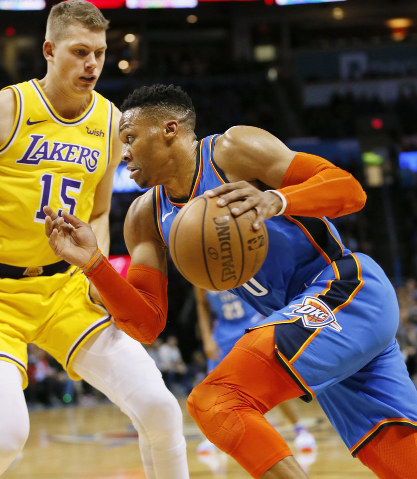 Photo - Oklahoma City's Russell Westbrook (0) drives against Los Angeles' Moritz Wagner (15) during an NBA basketball game between the Los Angeles Lakers and the Oklahoma City Thunder at Chesapeake Energy Arena in Oklahoma City, Thursday, Jan. 17, 2019. Photo by Nate Billings, The Oklahoman