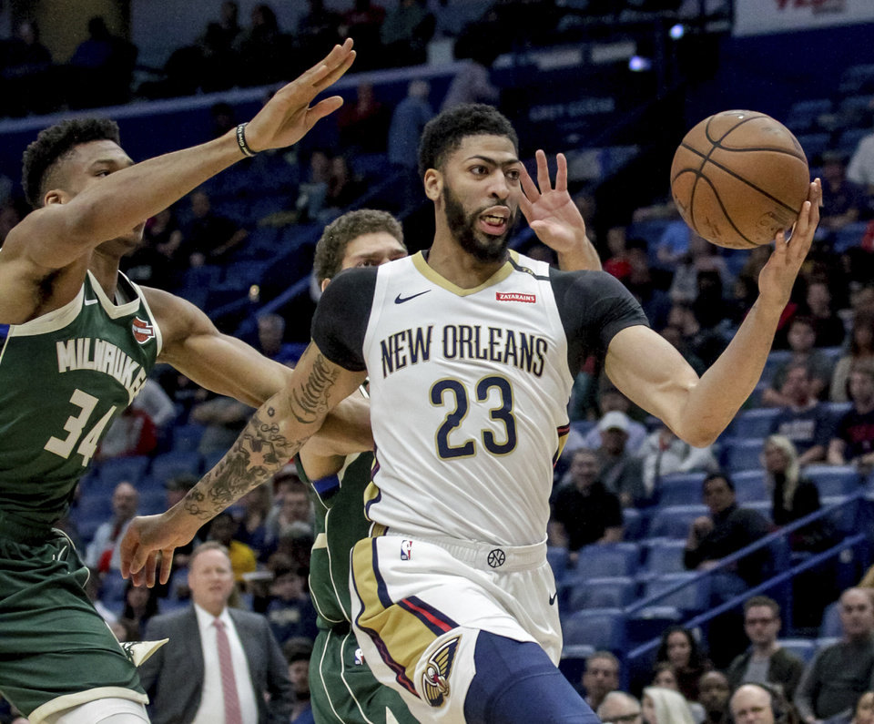 Photo -  FILE - In this Tuesday, March 12, 2019 file photo, New Orleans Pelicans forward Anthony Davis (23) takes an outlet pass against Milwaukee Bucks forward Giannis Antetokounmpo (34) in the first half of an NBA basketball game in New Orleans. Pelicans basketball operations chief David Griffin says the timing of next week's NBA draft won't necessarily raise urgency to trade disgruntled six-time All-Star Anthony Davis. The Pelicans have the first overall pick in the June 20 NBA draft and likely could acquire more high picks by dealing Davis by then.(AP Photo/Scott Threlkeld, File)