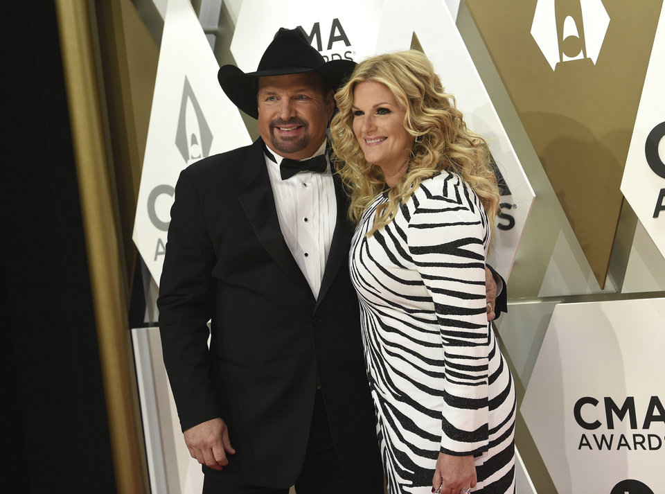 Photo - Garth Brooks, left, and Trisha Yearwood arrive at the 53rd annual CMA Awards at Bridgestone Arena on Wednesday, Nov. 13, 2019, in Nashville, Tenn. (Photo by Evan Agostini/Invision/AP)