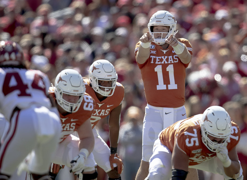 Photo - Texas quarterback Sam Ehlinger (11) directs his team against Oklahoma during the first half of an NCAA college football game at the Cotton Bowl, Saturday, Oct. 12, 2019, in Dallas. (Nick Wagner/Austin American-Statesman via AP)