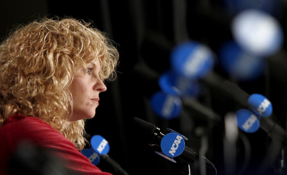 Photo - OU coach Sherri Coale is interviewed during a press conference room in Kansas City, Mo., on Monday, March 29, 2010. Oklahoma will play Kentucky in the regional championship game of the NCAA women's tournament on Tuesday, March 29, 2010.