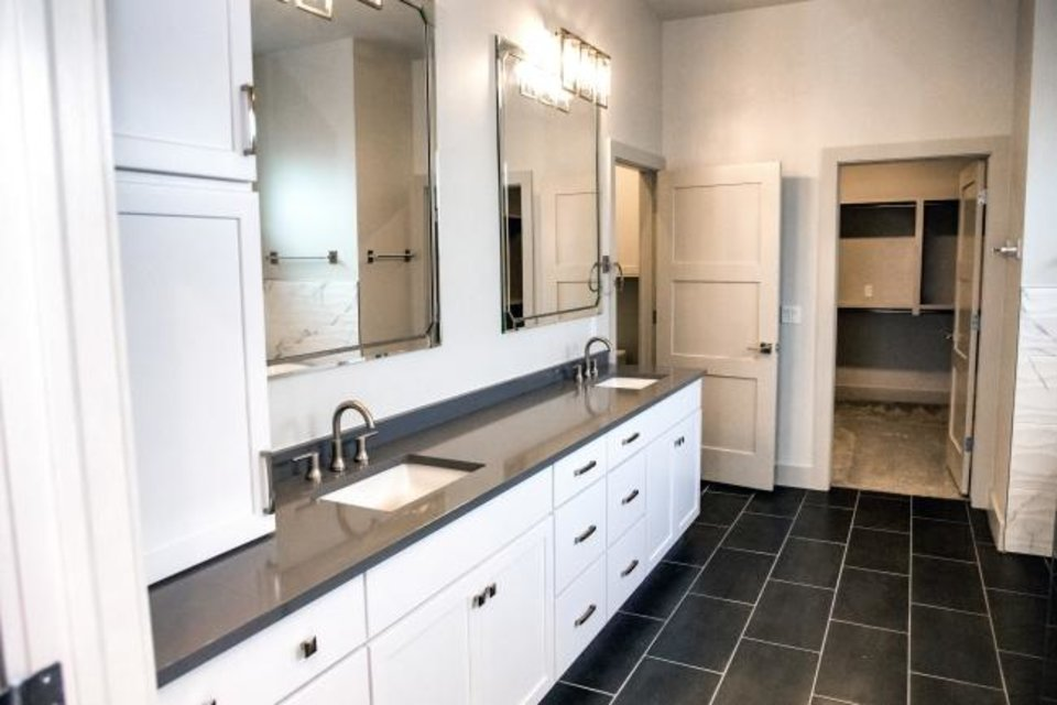 Photo -  Master bath at 850 NW 72 in the Wilshire Point development. [CHRIS LANDSBERGER/THE OKLAHOMAN]