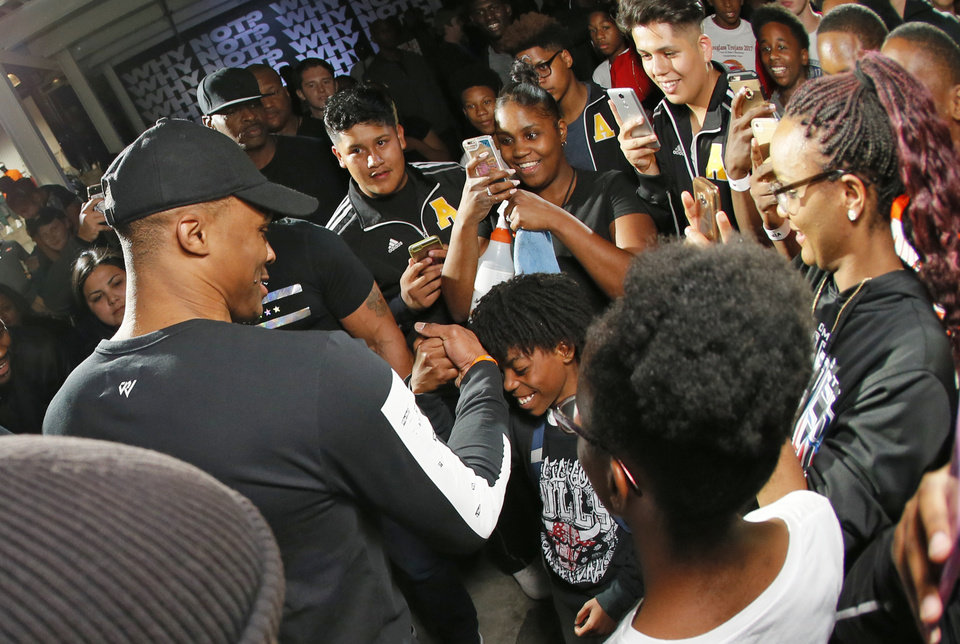 Photo - Russell Westbrook greets fans during a Why Not? Rally hosted by Westbrook and Jordan Brand at 8th Street Market in Oklahoma City, Monday, Oct. 16, 2017. Photo by Nate Billings, The Oklahoman