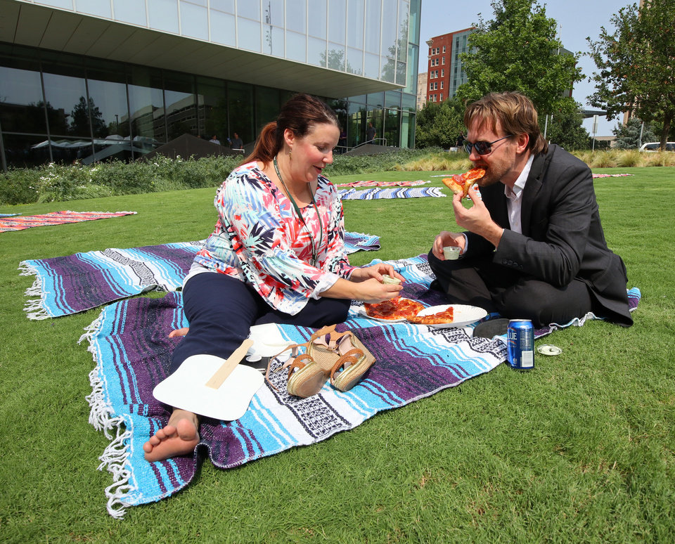 Photo -  Rebecca and Giles Weingart spent their lunch break Tuesday on a blanket during the Kerr Park Kickoff Party. Rebecca Weingart works at Junior Achievement's downtown office and Giles Weingart works at Jones PR, also located downtown.