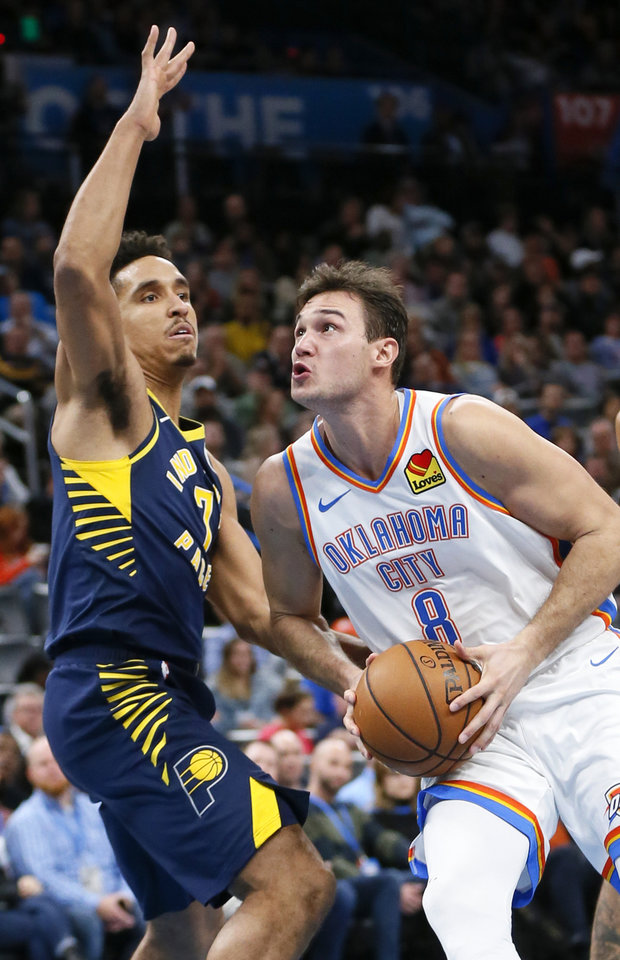Photo - Oklahoma City's Danilo Gallinari (8) takes the ball to the basket as Indiana's Malcolm Brogdon (7) defends in the second quarter during an NBA basketball game between the Indiana Pacers and the Oklahoma City Thunder at Chesapeake Energy Arena in Oklahoma City, Wednesday, Dec. 4, 2019. [Nate Billings/The Oklahoman]