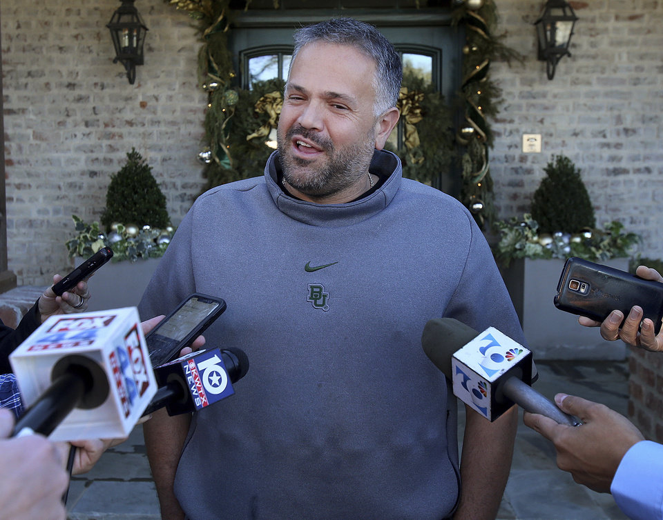 Photo - Former Baylor head football coach Matt Rhule speaks to reporters outside his home Tuesday Jan. 7, 2020, in Waco, Texas.  According to a person familiar with the situation, the Carolina Panthers are completing a contract to hire Baylor's Matt Rhule as their coach. The Panthers have not spoken publicly about the coaching search.(Jerry Larson/Waco Tribune-Herald via AP)