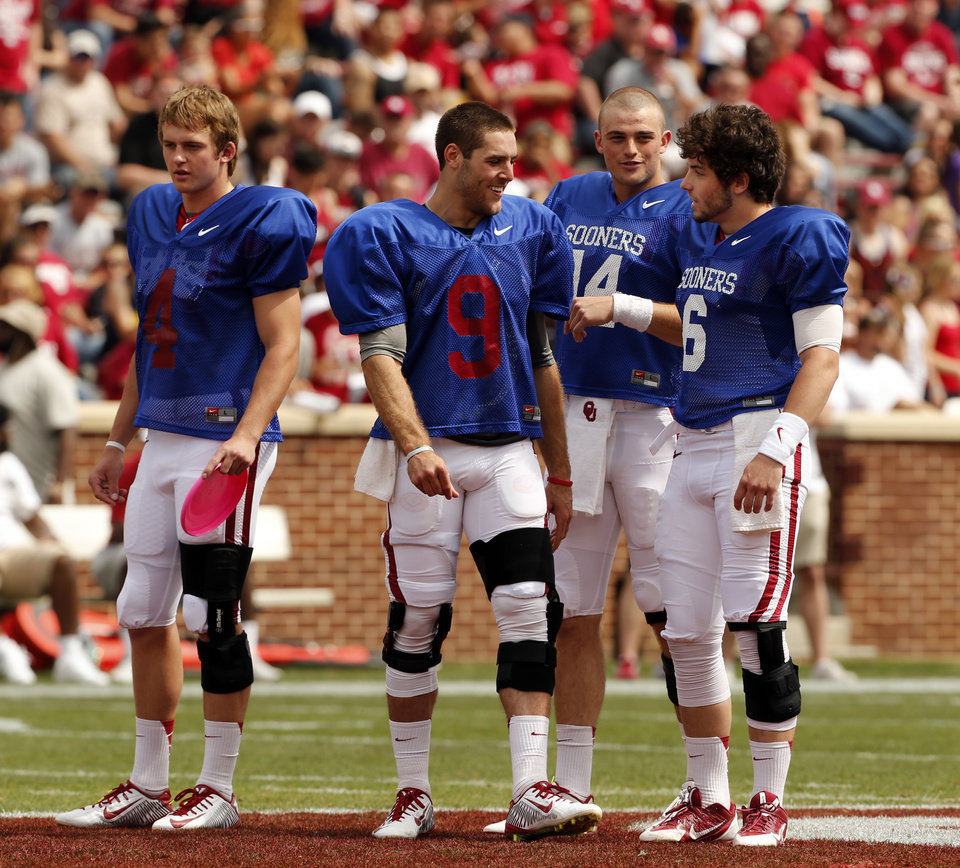 Photo -                    Quarterbacks Justice Hansen, Trevor Knight, Cody Thomas, and Baker Mayfield, from left to right, will compete for the starting job under new coach Lincoln Riley.                     Photo by Steve Sisney, The Oklahoman