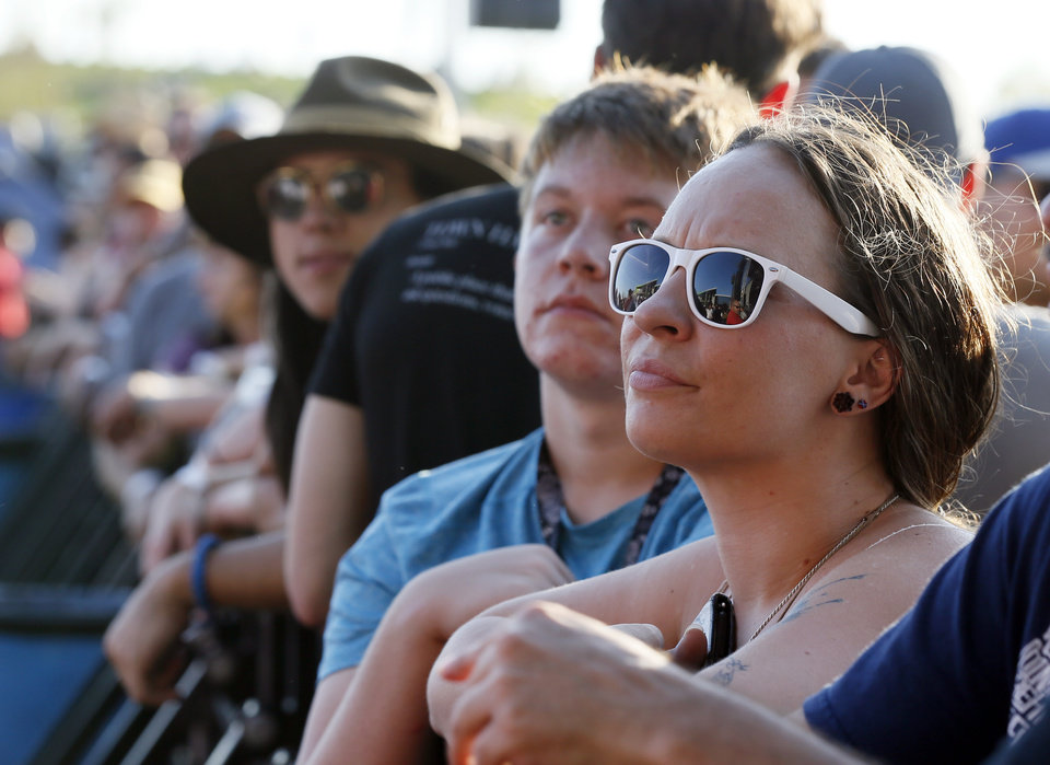 Photo - People near the stage wait for the concert to start during the grand opening of Scissortail Park in Oklahoma City, Friday, Sept. 27, 2019. [Nate Billings/The Oklahoman]
